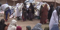 RAWA distributes quilts among refugees