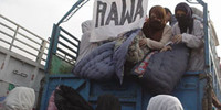RAWA distributes 8000 quilts among Afghan refugees