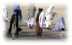 Seconds before execution a Taliban high ranked official ask Zarmeena to be silent and turn her face.