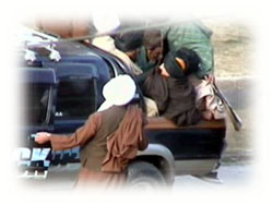 The Taliban leader leaves the ground with his gunmen after the execution.